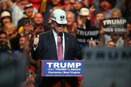 Donald Trump donning a miner's hardhat at a rally held in Charleston, West Virginia on May 5, 2016.