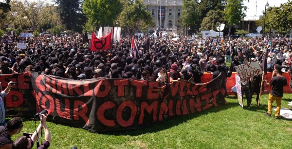 "A banner reading ""Avenge Charlottesville / Defend your community"" at the counter-protest for ""No To Marxism"" rally in Berkeley, California, on August 27, 2017."