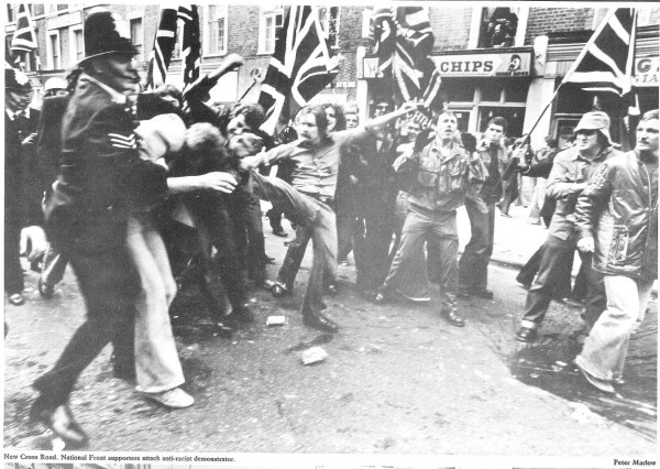 Photo by Peter Marlow of an altercation between National Front supporters and anti-racist counter-protesters at the Battle of Lewisham in New Cross, 1977.