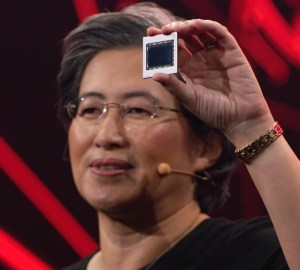Lisa Su holding the Big Navi chip used in the Radeon RX 6800, 6800 XT and 6900 XT GPUs.