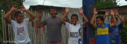 HANDS UP - Jama, Ecuador - They were solemn and unsmiling, so I asked them to raise their hands.. lower their hands... raise their hands.. raise their hands.. and of course everyone laughed when their hands went down that last time!