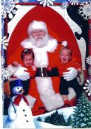 My twins, the first year I took them to meet the big guy.