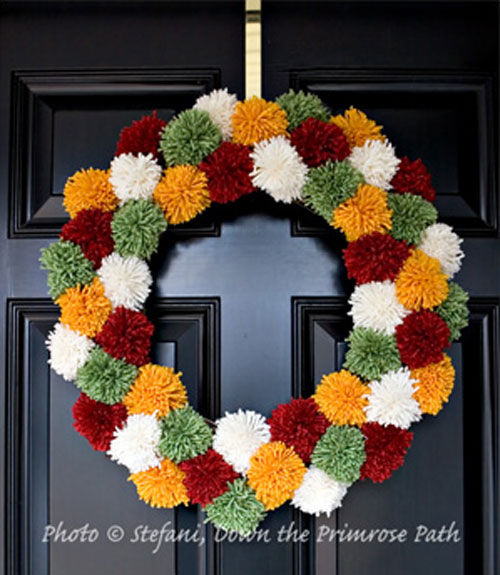 5 Clever and Colorful Fall Wreaths: A pom pom wreath makes me want to curl up under a blanket with a cup of hot cocoa!