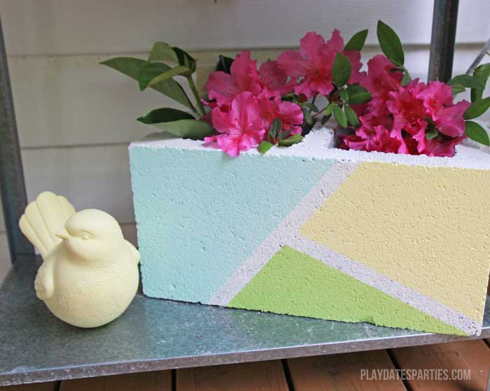 Cinder blocks aren't just for building. By using some leftover paint and some masking tape, you can turn it into a modern-industrial looking vase!