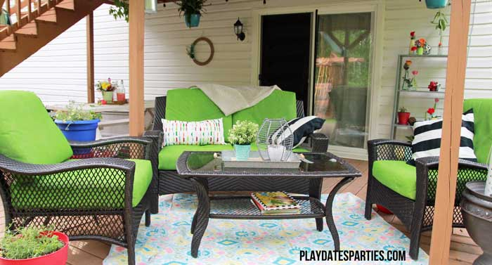 Take a look at this backyard renovation, with loads of DIY projects to get your backyard ready for summer entertaining. Projects include a homemade pallet bar, painted patio cushions, painted patio furniture, a DIY privacy screen, outdoor lighting and more!