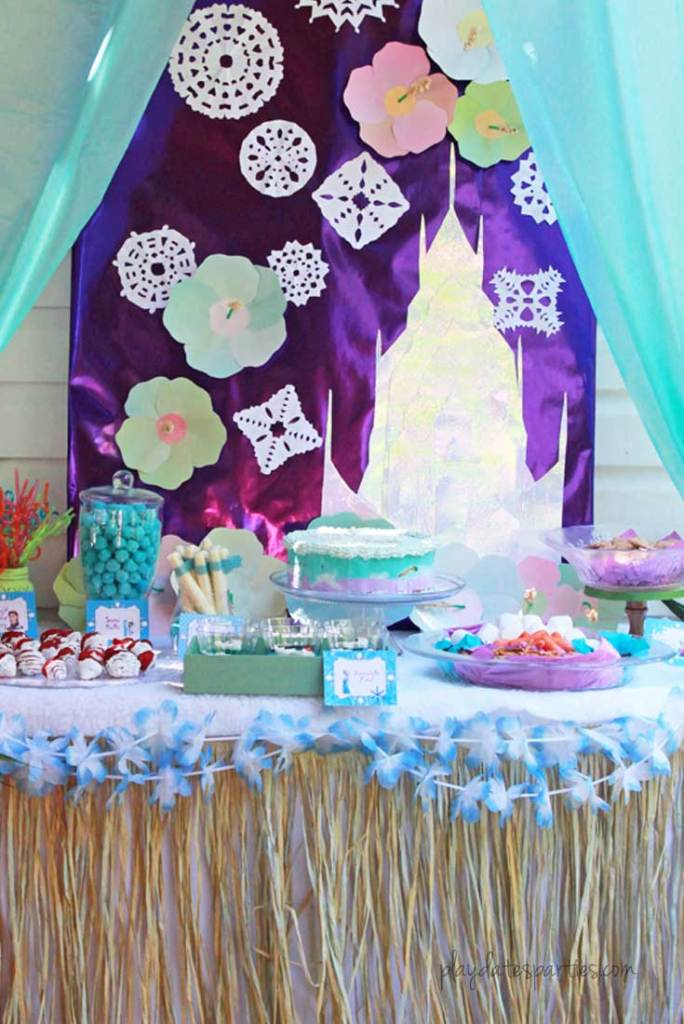 This stunning Frozen luau party is full of easy DIY projects and simple tips that you can absolutely recreate for a special little girl in your life. Including: an Olaf snow flurry, Olaf jello cups, a fake snow beach, a purple and blue ice cream cake, and lots of snowflakes everywhere!
