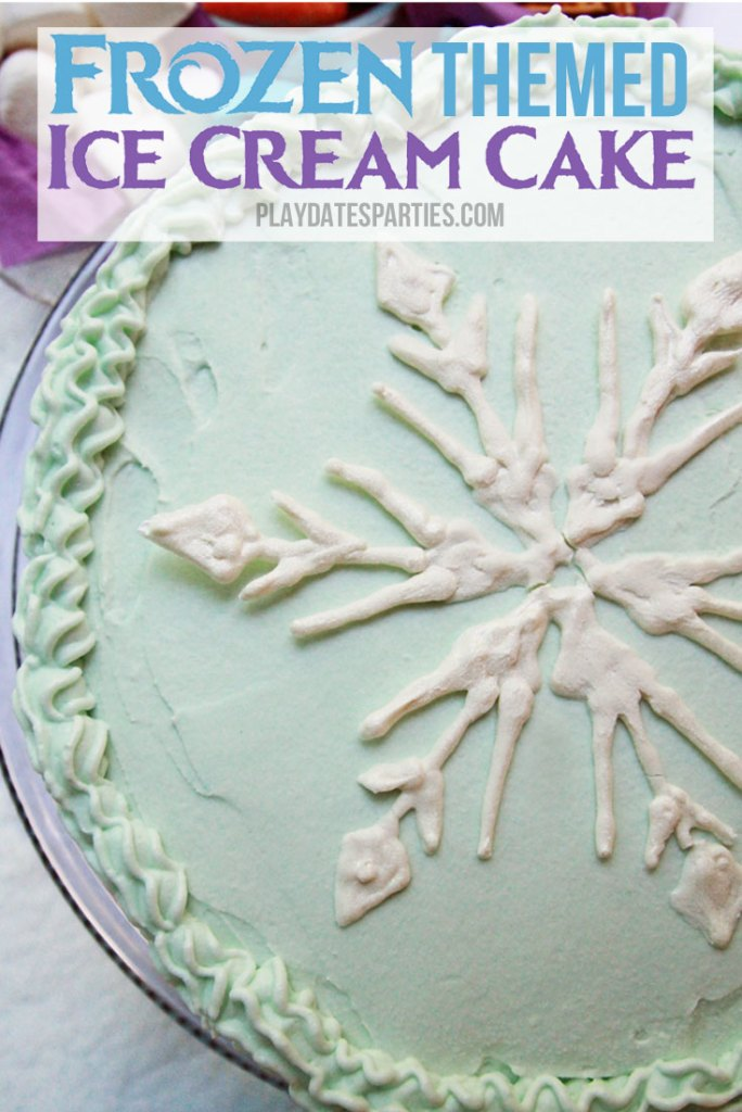 Got a little kid who loves Disney's Frozen? Anyone can make this stunning Frozen themed ice cream cake with layers of white cake, blue and purple ice cream, and then covered with whipped cream frosting and a candy snowflake.