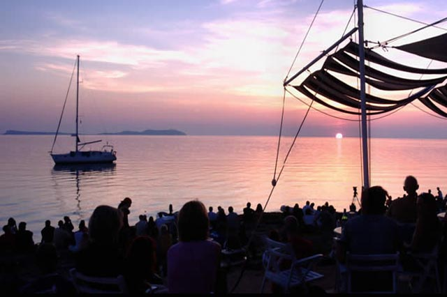 Watch the sunset at Cafe Del Mar.