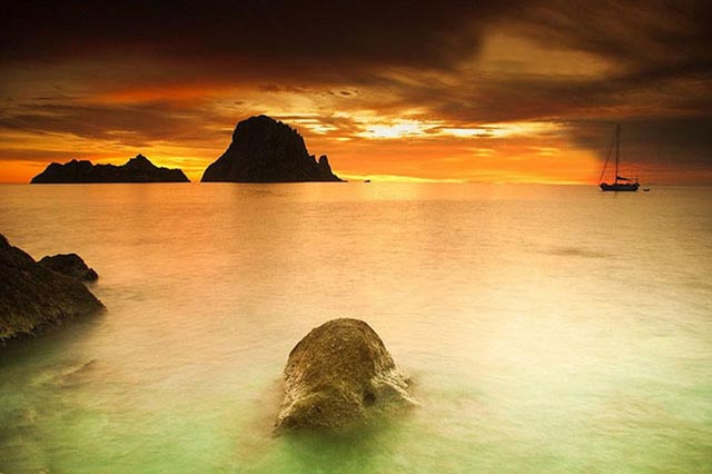 Visit Cala D'Hort to see the famous rock of Es Vedra.