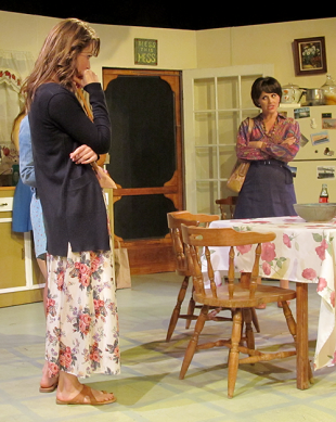 Chick Boyle, also known as chicken to the sisters, is a southern socialite played by Jennifer Maddern (right). She scolds her cousin Meg Magrath, played by Cody Ganger (left), about her leaving for California after Meg's free spirited ways nearly got Meg's old boyfriend, Doc Porter killed and the shame it brought to Chick.