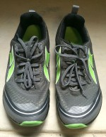 Black or dark gray, the quintessential color for trail shoes.