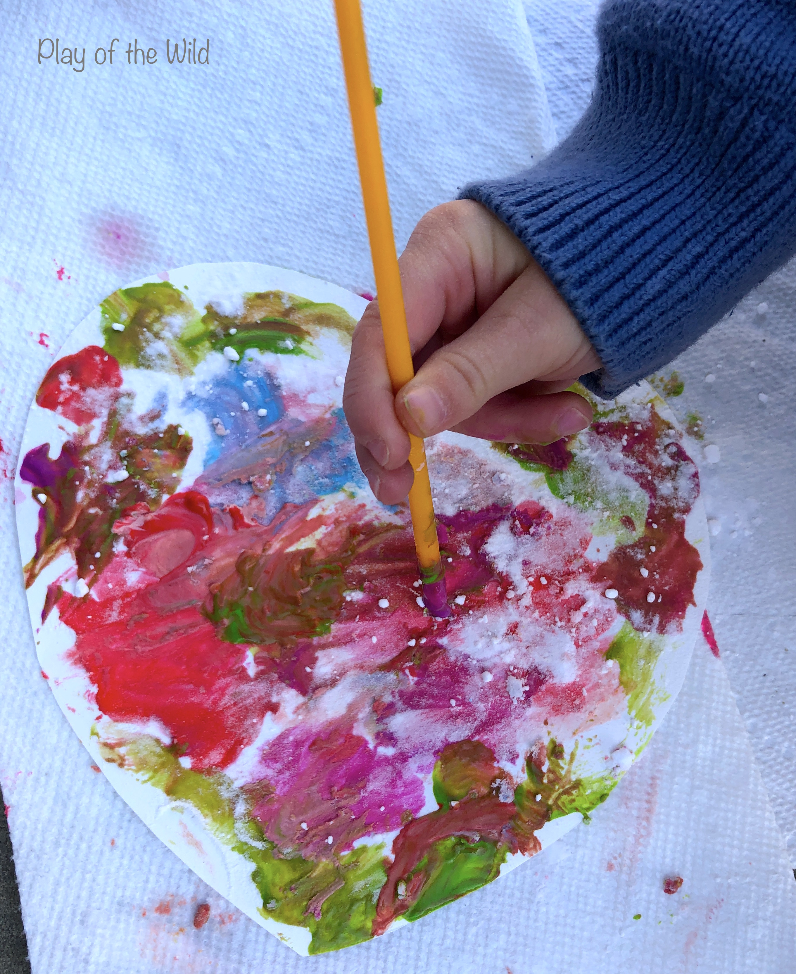 valentines art for kids. painting a heart.