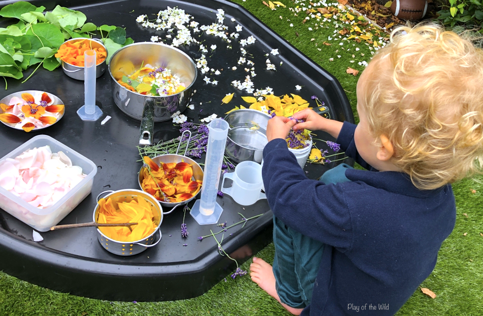 Loose parts play ideas for toddlers. potion making on tuff tray.