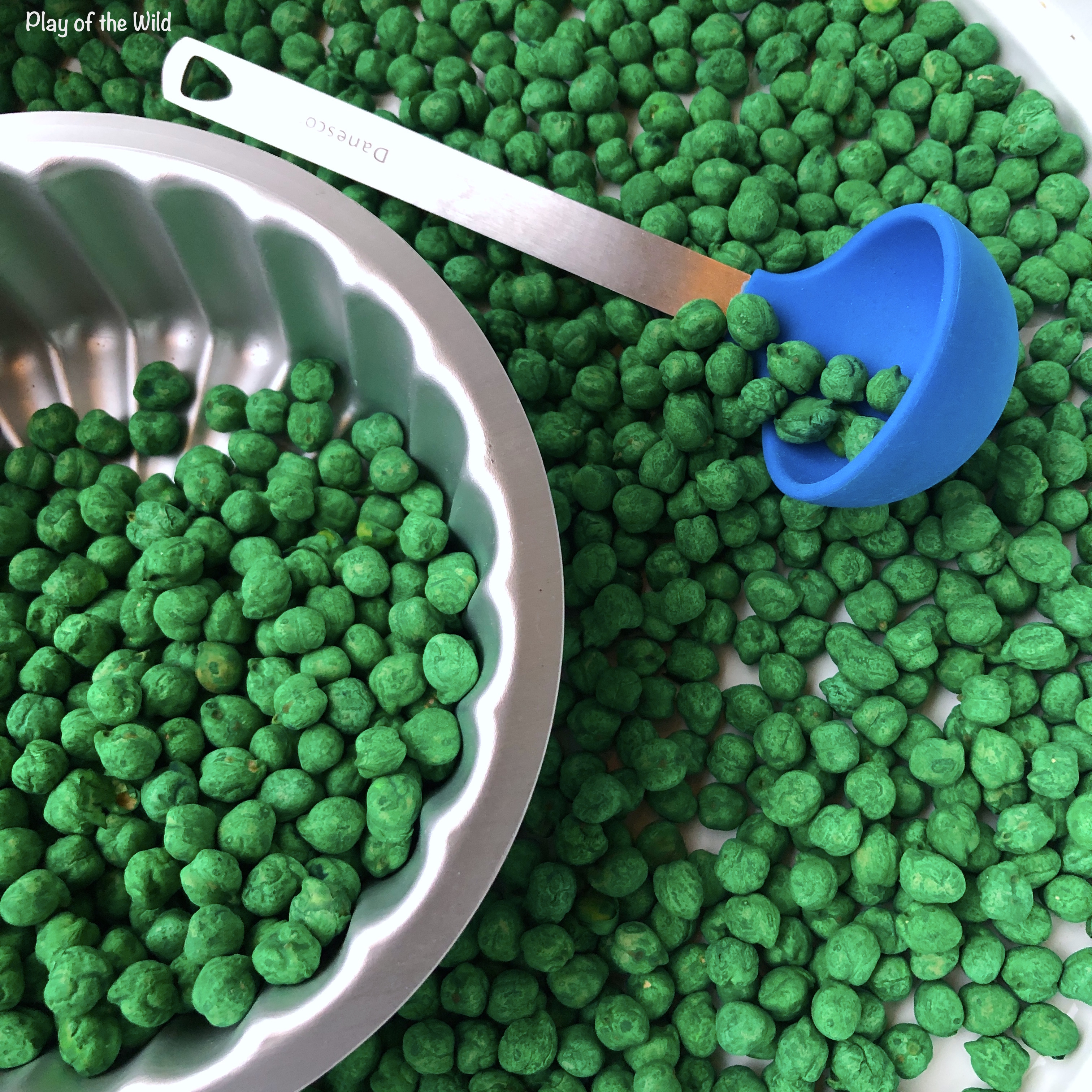 sensory play with colorful chickpeas