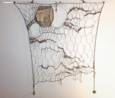 Guardian, linen, handmade paper, quartz, wood beads, plexiglas rod, 42x36""
