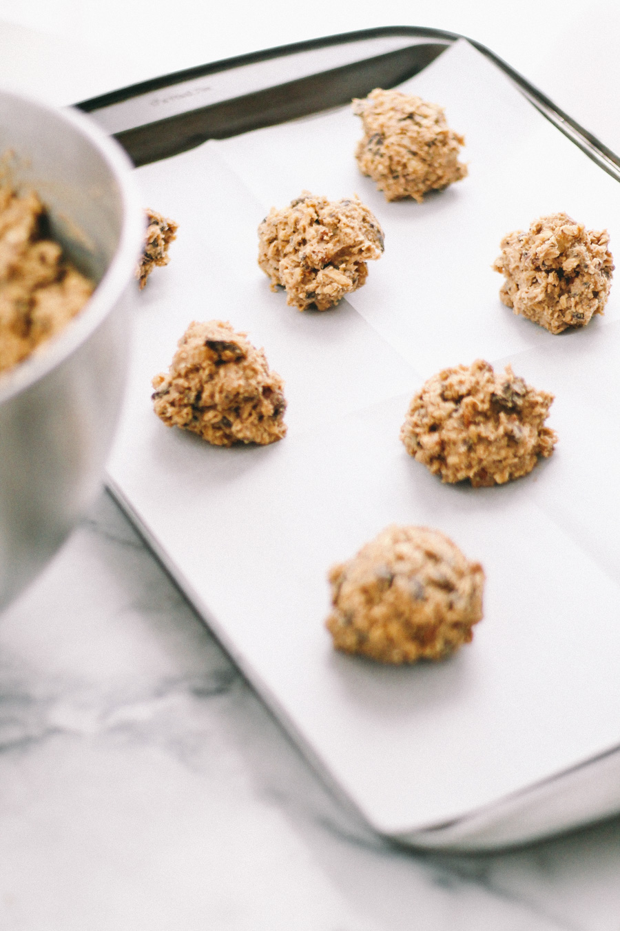 dark chocolate chunk oatmeal cookies with walnuts, pecans, & sea salt via playswellwithbutter | not your average chocolate chip cookie, dark chocolate chunk oatmeal cookies have the perfect crunchy yet chewy texture & are loaded with rich chunks of dark chocolate, walnuts, & pecans. finished with just a kiss of sea salt, these perfect cookies will have you coming back for more!