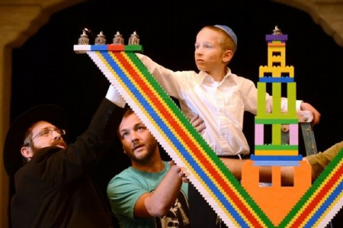 KAREN QUINCY LOBERG/THE STAR Yakov Lang has the honor of lighting the large menorah made of Legos on Wednesday, the day of his eighth birthday at Constitution Park in Camarillo on Wednesday. Read more: http://www.vcstar.com/photos/galleries/2013/dec/04/lego-menorah/#ixzz2ovZ4QGJV  - vcstar.com