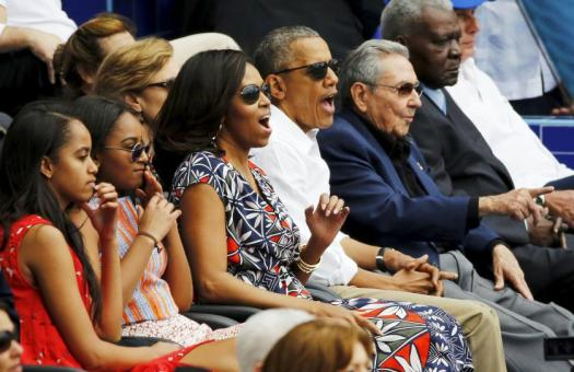 U.S. President Barack Obama and his family react along with Cuban President Raul Castro to an exhibition baseball game between the Cuban National team and the MLB Tampa Bay Rays at Estadio Latinoamericano in Havana March 22, 2016. REUTERS/Jonathan Ernst TPX IMAGES OF THE DAY