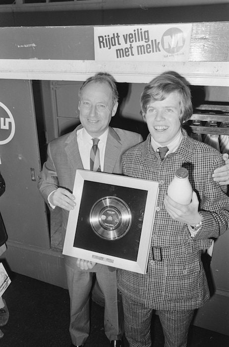 """Peter Noone receiving a gold record for """"No Milk Today""""."""