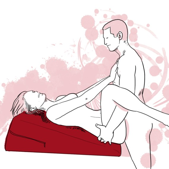 A sketch of a naked woman lying on her back on The Liberator Ramp sex position aid having sex with a naked man who is standing in front of her holding her hips with his hands.