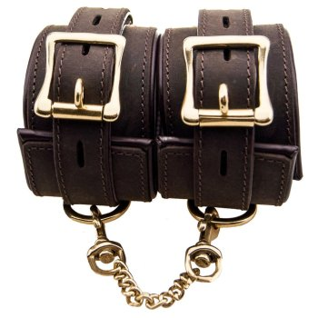 A pair off Bound Nubuck Leather wristcuffs with large brass buckles and linking chain