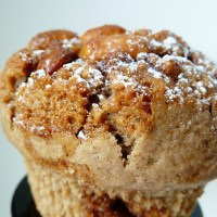 Sky high cinnamon muffins with coffee swirl and peanuts