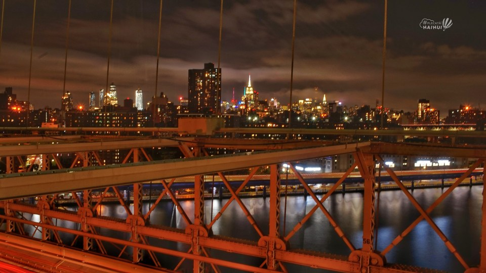 view downtown new york from brooklyn bridge
