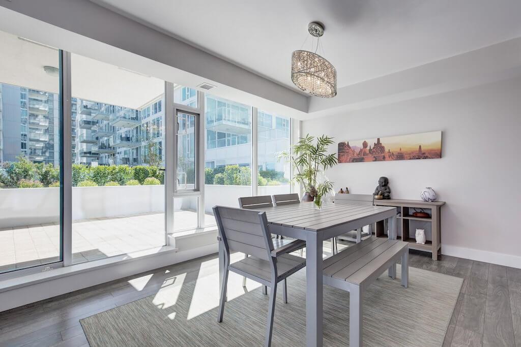 Floor-to-ceiling-windows-dining-room-evolution-Realtor-210-510-6-Avenue-SE-east-village-calgary-real-estate-for-sale-condo-plintz-sothebys
