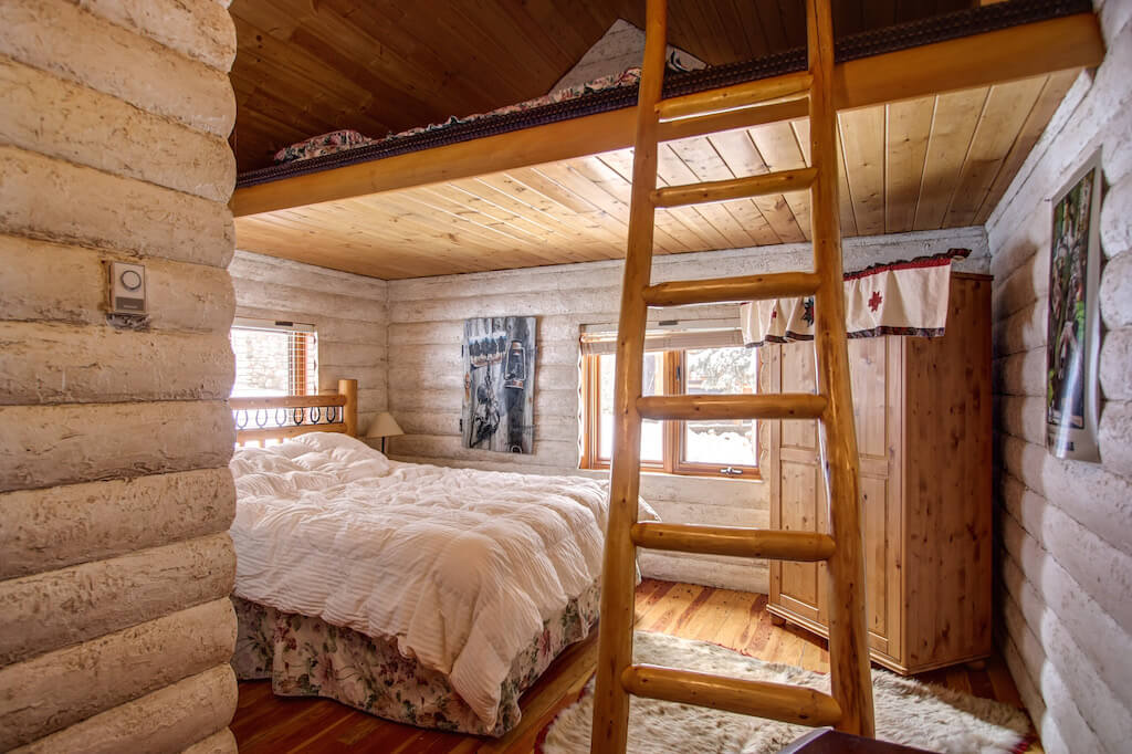 Cabin-loft-bedroom-352248-Pine-Ridge-Road-Bragg-Creek-Ranch-Acreage-For-Sale-Calgary-Real-Estate-For-Sale-taylor-sothebys-Realtor-Plintz