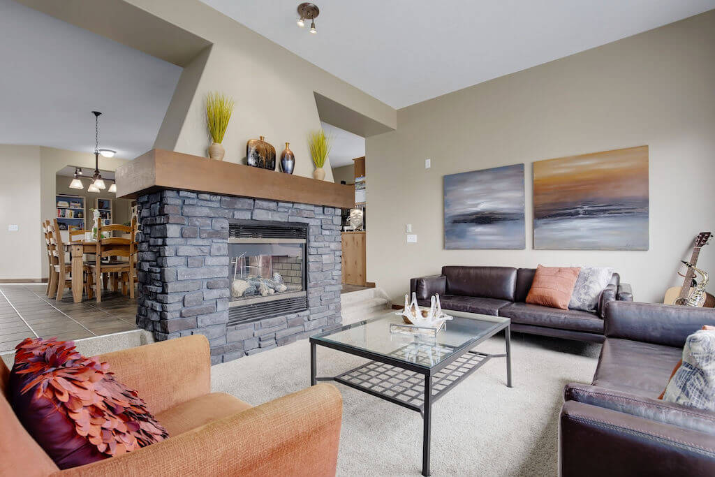 stone-fireplace-303-Valley-Crest-Court-NW-Valley-Ridge-Plintz-Real-Estate-For-Sale-Calgary-Alberta