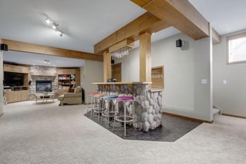 river-stone-wetbar-basement-303-Valley-Crest-Court-NW-Valley-Ridge-Plintz-Real-Estate-For-Sale-Calgary-Alberta