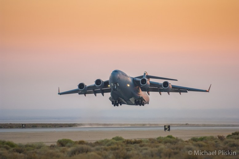 C-17 Globemaster III takes off at Edwards Air Force Base at sunrise