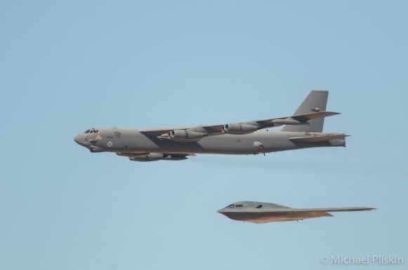 B-52 Stratofortress from the 1950s flies with the B-2 Spirit Stealth Bomber (from the late 1980s) at Edwards Air Force Base