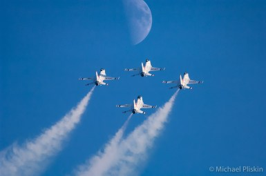 U. S. Air Force Thunderbirds F-16 Falcons fly towards the moon