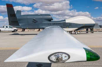 The very first RQ-4 unmanned Global Hawk autonomous reconnaissance aircraft ever deployed overseas, after its return to Edwards AFB, CA. Note the mission stencils painted on the fuselage.