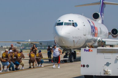 A team from UPS pulls a FedEx cargo plane at the Special Olympics Plane Pull fundraiser in Long Beach, CA.