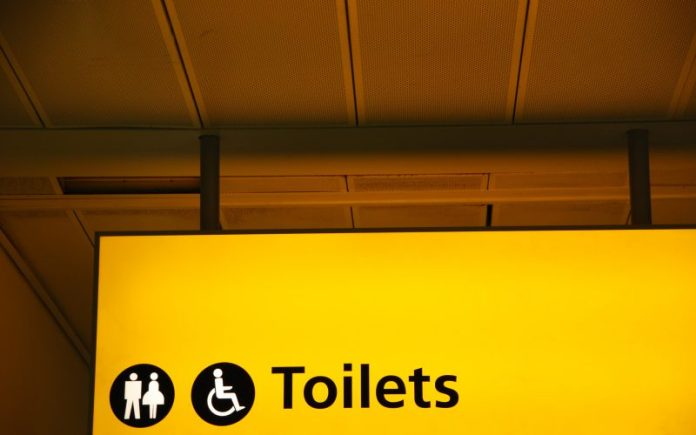 yellow public toilets WC sign (men, women and wheelchair)