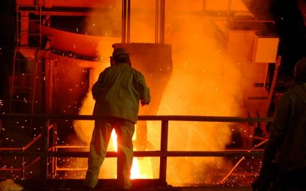 030910-N-7542D-240Amite, La. (Sept. 10, 2003) Ð- A worker from the Amite Foundry supervises the pouring of molten steel recycled from the World Trade Center into a ladle. It is being used to as part of the bow stem of the Amphibious Transport Dock ship USS New York (LPD 21). About 24 tons of steel was salvaged from the World Trade Center, that was destroyed in the terrorist attacks of Sept. 11, 2001. Approximately 10-percent of the steel was lost when the foundry superheated the 48,780 pounds of steel to 2,850 degrees Fahrenheit. U.S. Navy photo by Photographer's Mate 1st Class Dean Dunwody. (RELEASED).