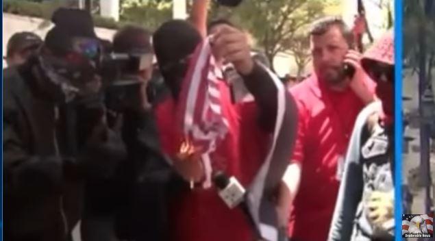 antifa protests flag burning