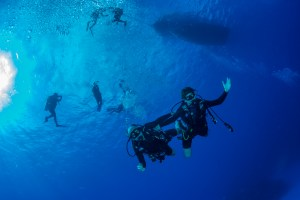 Diver try scuba diving for the first time with instructor