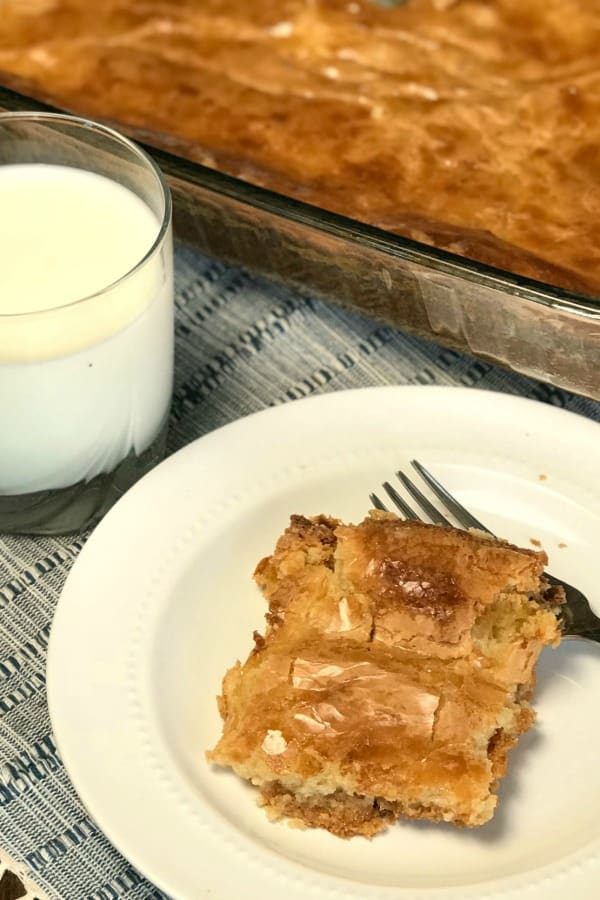 Gooey Butter cake is an easy homemade from scratch cake that is great for dinner parties, carry-ins, and big family meals.  The best part about this delicious and Gooey Butter cake is it's made with common ingredients.