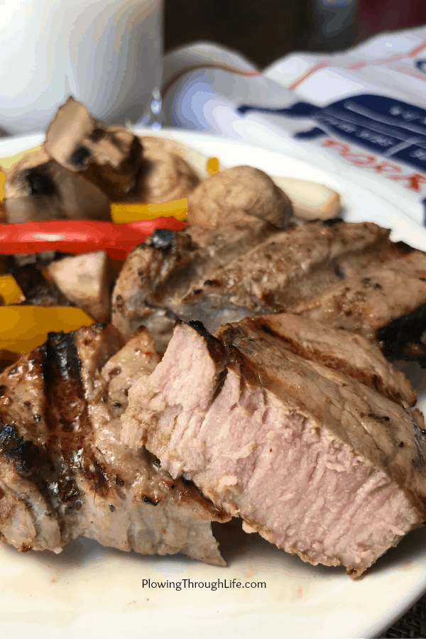 Pork tenderloin is done cooking when the meat thermometer reads 145 degrees F.  Whole muscle cuts of meat are their juiciest best when cooked to 145 degrees F., removed from the heat and allowed to rest for 3 to five minutes before slicing or eating.