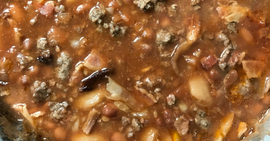 Are you looking for a great meal that's loaded with meat and has a side of bacon?  Then you'll LOVE these Meaty Farmhouse Baked Beans!  These ultimate meat baked beans show up at family parties regularly!