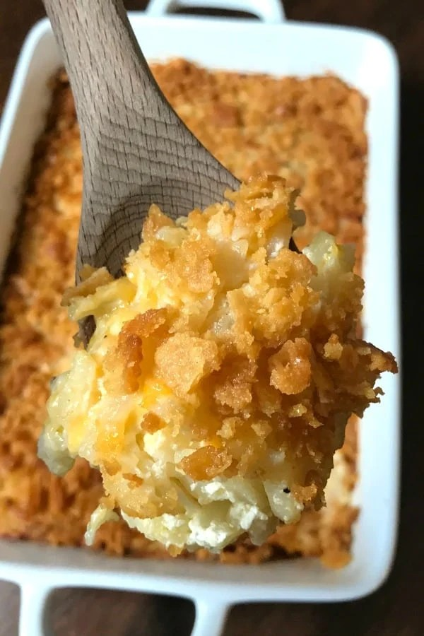 Even though we've eaten a lot of potatoes on the farm I've never had a cheesy potato casserole as good as this one.  This potato casserole is so creamy, cheesy and delicious!  I can't count how many times I've made this recipe since my sister-in-law gave it to me almost ten years ago.  We make these easy cheesy potatoes for parties, potlucks, holidays and anytime we want a nice dish that people will enjoy and remember.