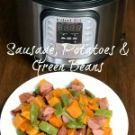 Plate of sweet potatoes, smoked sausage and green beans next to Instant Pot