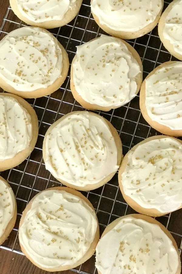 These Sour Cream Cookies are moist, fluffy and simply the best cut out cookies I've ever made!  We used homemade icing for part of them and a can of icing for the rest. Both options were excellent.  A few sprinkles finished them off! #cookies