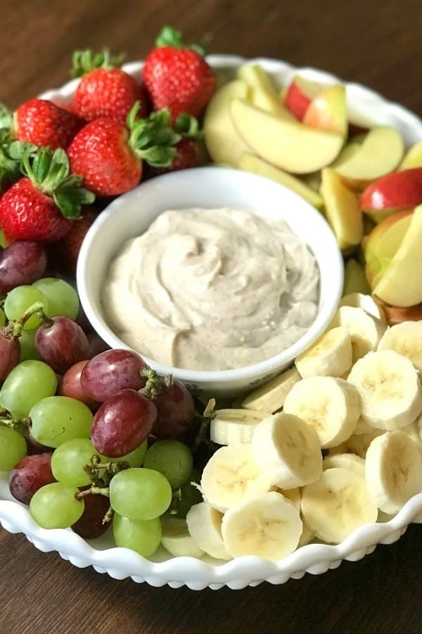 Fruit trays are one of my favorite things to take along to big parties and potlucks.  People of all ages enjoy some type of fruit and this fruit dip is so easy.  In this post I will share tips and ideas for How to Make a Fruit Tray!