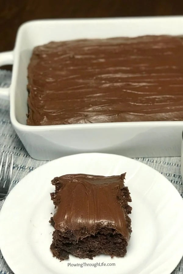 Are you craving a delicious chocolate cake? This is the BEST rich and moist chocolate cake from a box mix that is unbelievably EASY to make! This is a bakery quality cake that anyone can make at home with common ingredients! #chocolatecake #easycake