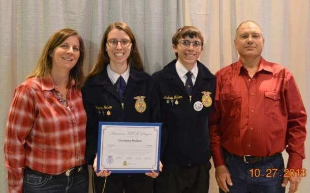 Courtney with family earning American Farmer degree in FFA