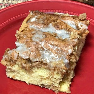 Are you craving a sweet cake from a box mix that tastes like bakery quality?  This Sticky Bun Swirl Cake is so easy to make and my son and husband LOVE it!  A box cake mix is enhanced with a couple layers of brown sugar and cinnamon swirled together and drizzled with icing. #boxmixcake #easycake
